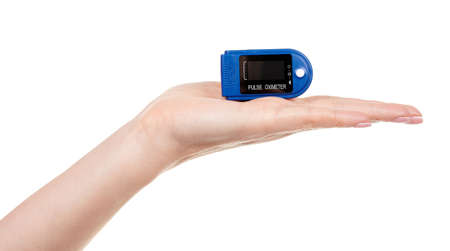 Hand with medical oximeter isolated on white. Stock fotó