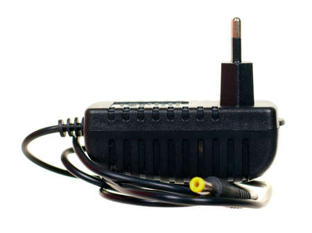 Black power adapter isolated on white.