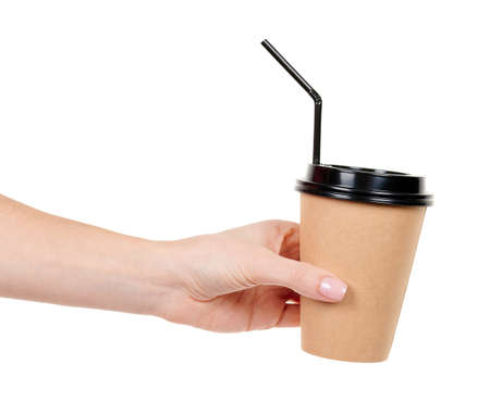 Hand with cardboard cup with black straw isolated on white.