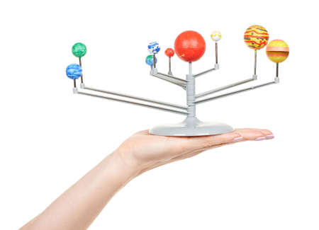 Hand with model of solar system isolated on white