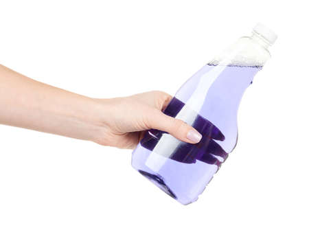 Hand with purple detergent for cleaning isolated on white
