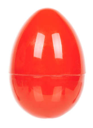Red plastic egg isolated on white.