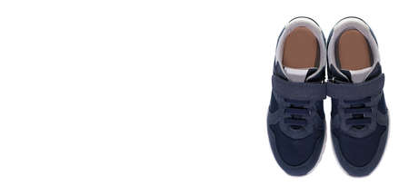 Childrens blue casual sneakers, isolated on white background. High quality photo 版權商用圖片