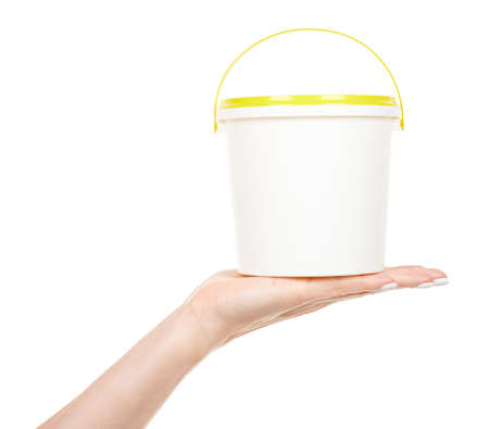 Hand with white paint bucket isolated on white 版權商用圖片