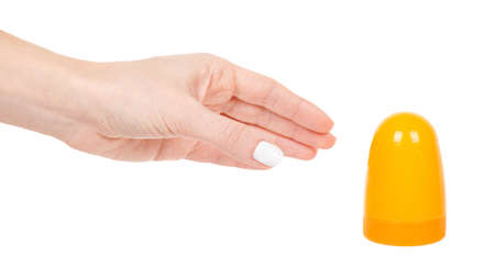 Hand with yellow bottle with slime isolated on white
