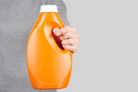 Hand with washing detergent on grey 版權商用圖片
