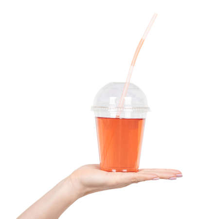 Hand with fresh summer coctail with straw isolated on white