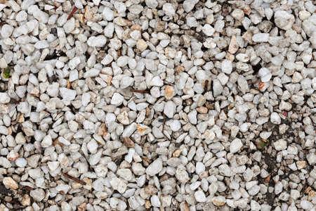 White pebble close up image, stone texture.