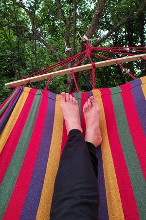 Feet on the hammock background. Zdjęcie Seryjne