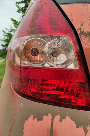 Dirty car tail lights, close up.