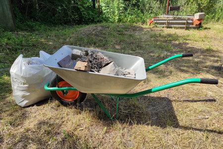 Wheelbarrow with green hadles with construction Zdjęcie Seryjne