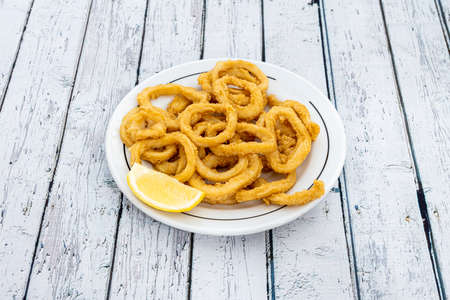 Portion of fried squid a la romana on a round plate