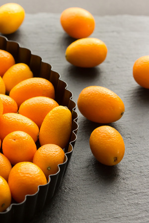 cumquat: Kumquats On Dark Surface Table