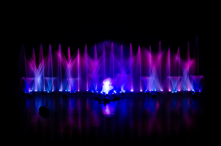 The musical fountain with a black background.