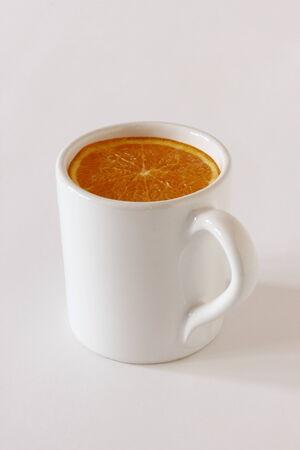 anther: A strange way to drink an orange juice Stock Photo