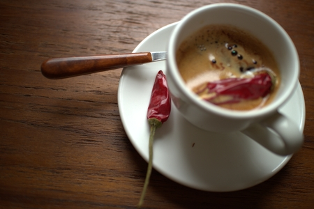 Coffee with chilly pepper photo