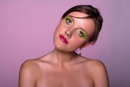 Sexual russian lady. Green-yellow make-up. photo