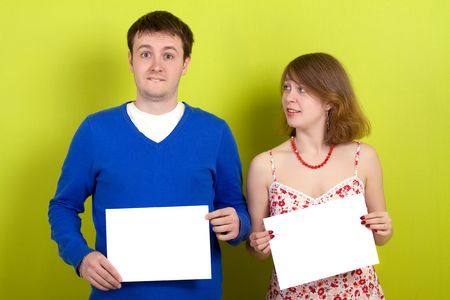 People holding a blank paper. On green background. photo