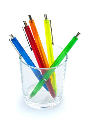 Multi-colored pens. Isolated on white. Selective focus. photo