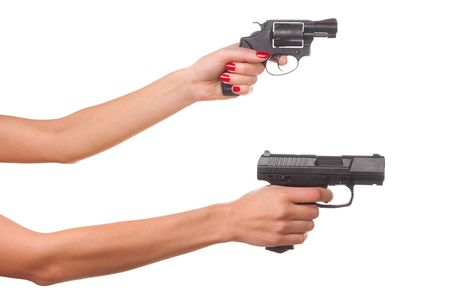 Womans hand with a gun. Isolated on white. photo