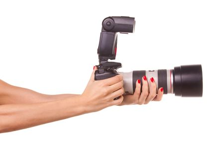 telezoom: Womens hands holding the camera. Isolated on white. Stock Photo