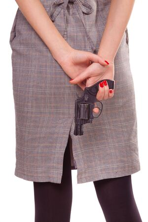 woman handle success: Woman and a gun. Close-up. Isolated on white.