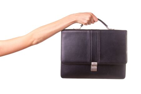 woman holding bag: Woman hands and suitcase. Isolated on white. Stock Photo