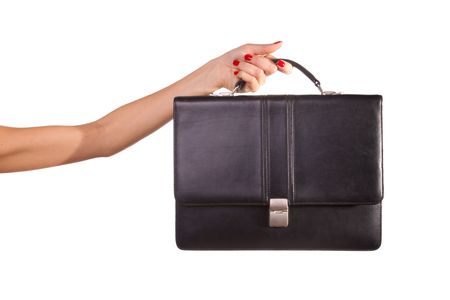 Woman hands and suitcase. Isolated on white. photo