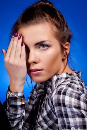 Woman portrait. On blue background. photo