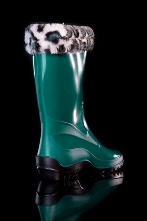 Glamorous womens boots. Isolated on black. photo