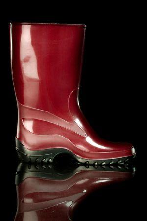 Gumboots. Isolated on black + reflection. photo