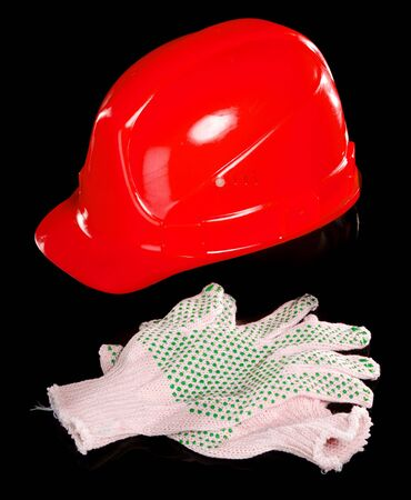 Hard hat and work gloves isolated on white background photo