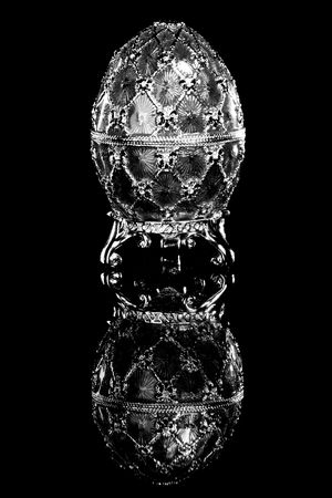 Faberge egg. Isolated on black. photo