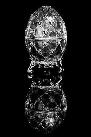 Faberge egg. Isolated on black. photo