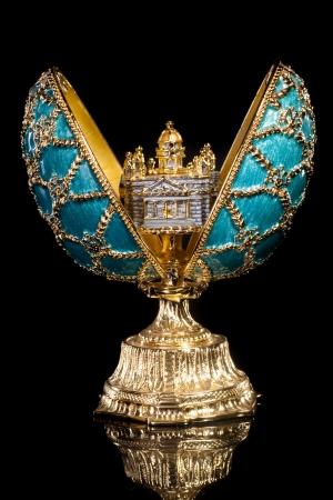 gold egg: Faberge egg. Isolated on black. Stock Photo