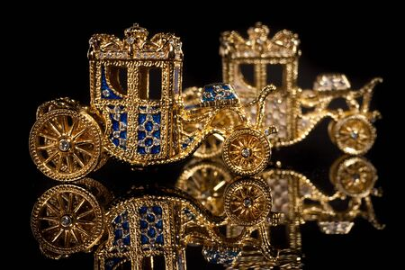 Faberge carriage. Isolated on black. Stock Photo