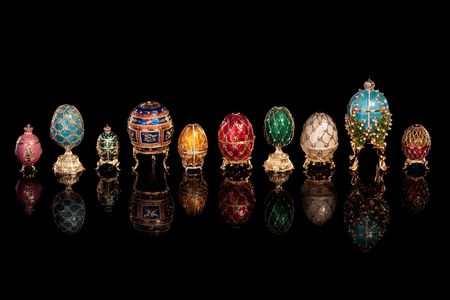 Group Faberge eggs. Isolated on black.