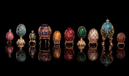 gold eggs: Group Faberge eggs. Isolated on black.