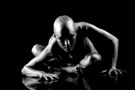 Beautiful bald woman. On black background. Stock Photo - 7775293