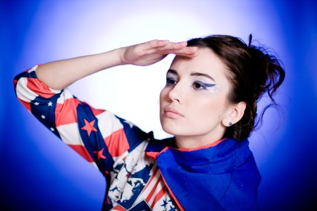 Superwoman. On blue background. Portrait. photo