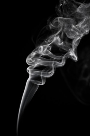 Tobacco smoke. On black background.