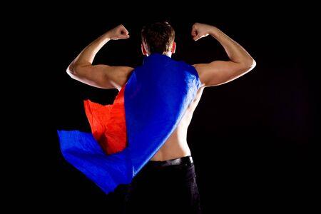 Superhero. On black background. Red-blue cloak. Stock Photo - 7775298