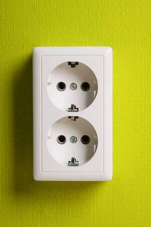 White electric socket on the wall. Close up. Stock Photo - 7775508