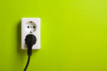 White electric socket on the wall. Close up. photo