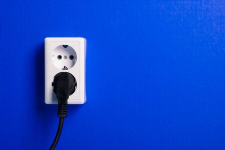 grounded plug: White electric socket on the wall. Close up.