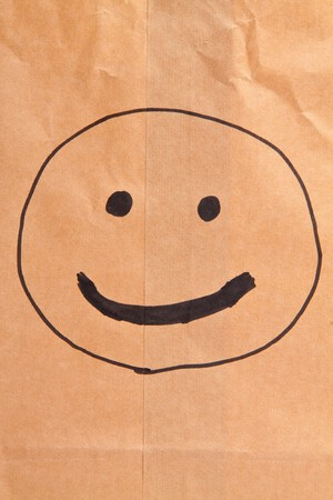 Smiling paper bag. Concept. Isolated on white. photo