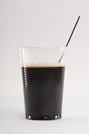 Coffee in plastic cup. On gray background. photo