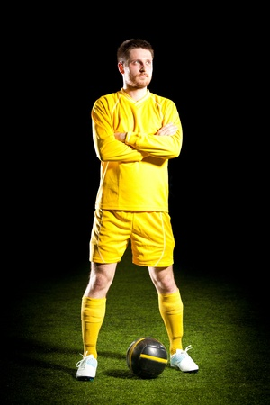 Football player on grass field photo