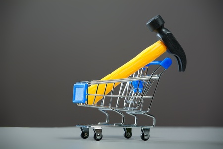 Shopping carts with a hammer. Stock Photo - 10300146