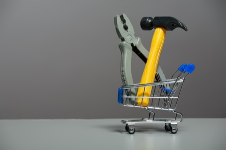 Shopping carts with a hammer and pliers photo
